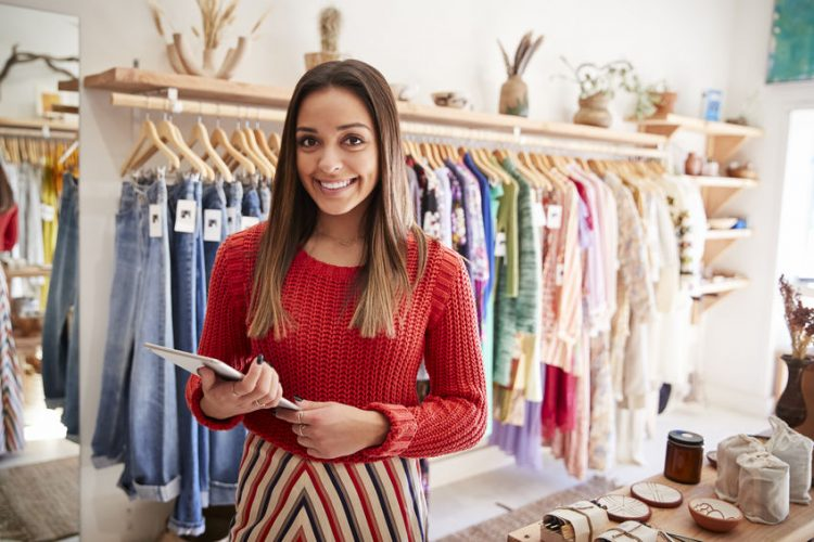 Portrait Of Female Owner Of Independent Clothing And Gift Store With Digital Tablet
