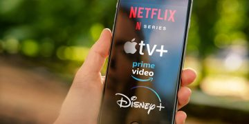 AACHEN, GERMANY - 10. September 2019 : Video Streaming apps like Disney plus, Apple TV plus, amazon prime and netflix on Apple iPhone.