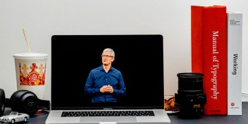 London, United Kingdom - September 13, 2018: Apple Computers internet website on 15 inch 2018 MacBook Retina in room environment showcasing Keynote in Cupertino Tim Cook saluting Audience
