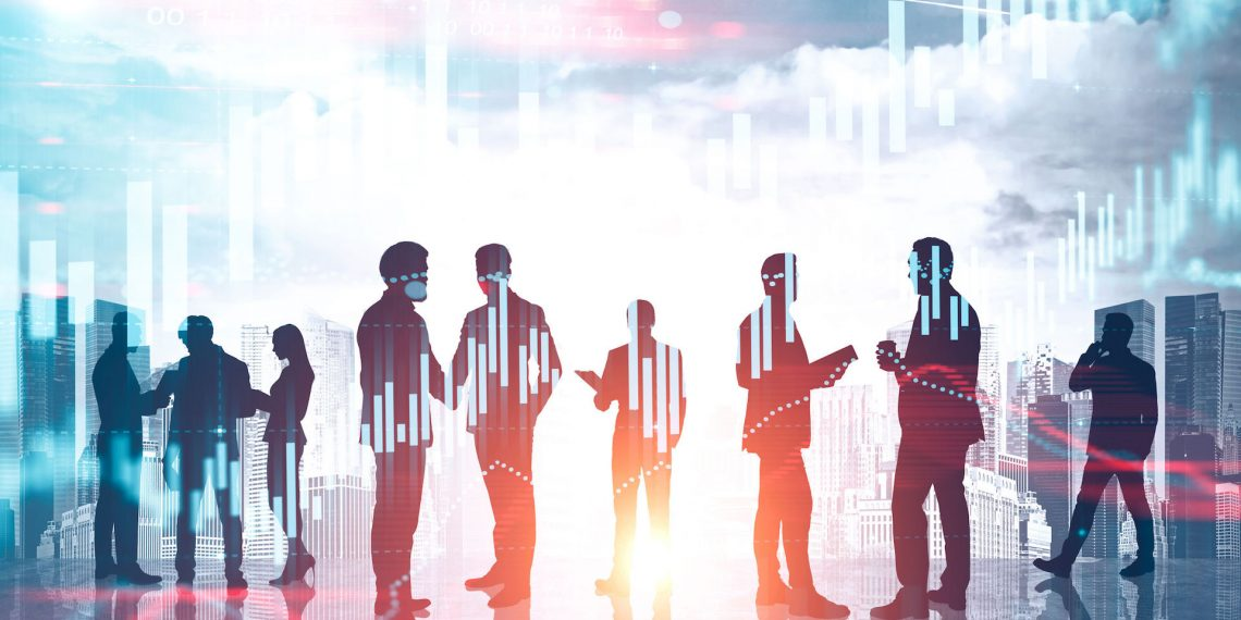 Diverse business team over cityscape background with forex graphs. Concept of financial market. Toned image double exposure