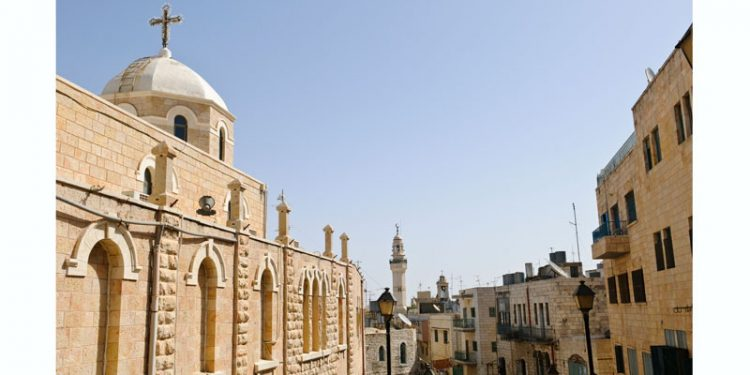 """""""A Christian church stands along Paul VI Street, a pedestrian road that leads into Manger Square in the West Bank town of Bethlehem, Palestine. In the background is the minaret of the Mosque of Omar, which is located on Manger Square.More images from Jerusalem and the West Bank:"""""""