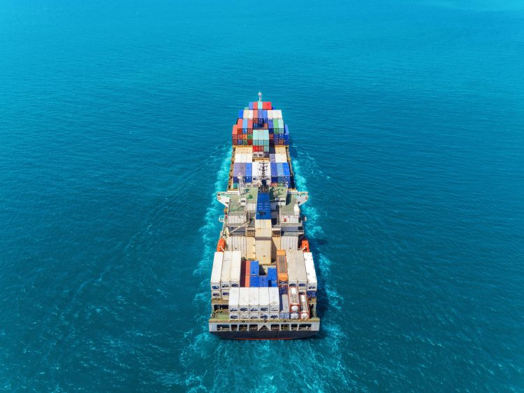 Aerial view container ship at sea full load container for logistics import  export or transportation concept background.
