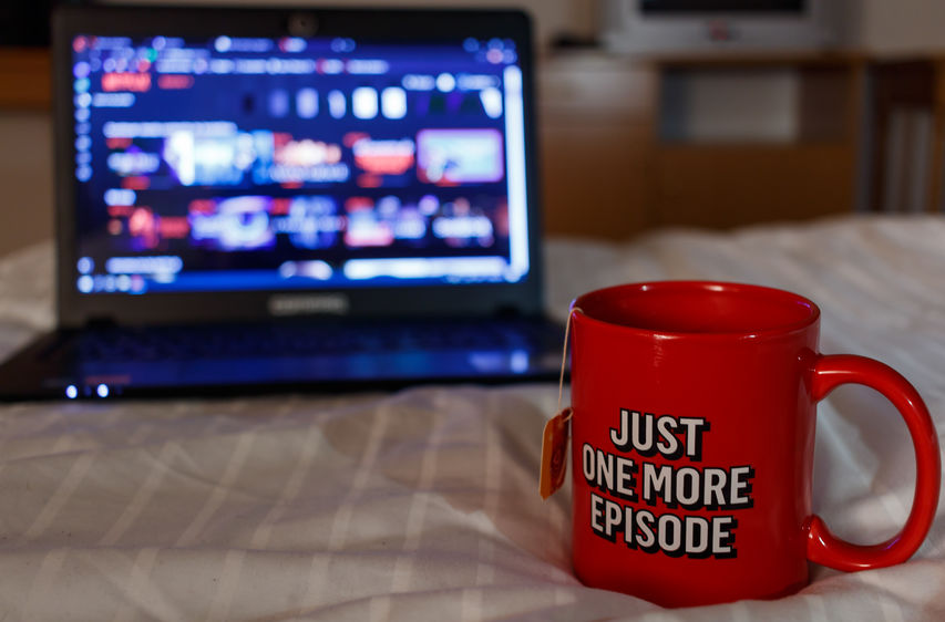 Watching series with a cup of tea. Inscription Just one more episode. Millennial concept