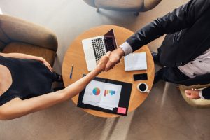 Hand shake at business meeting agreement sales